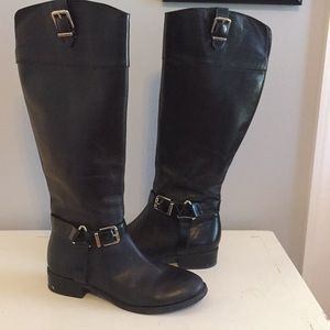 Tall , black , leather boots